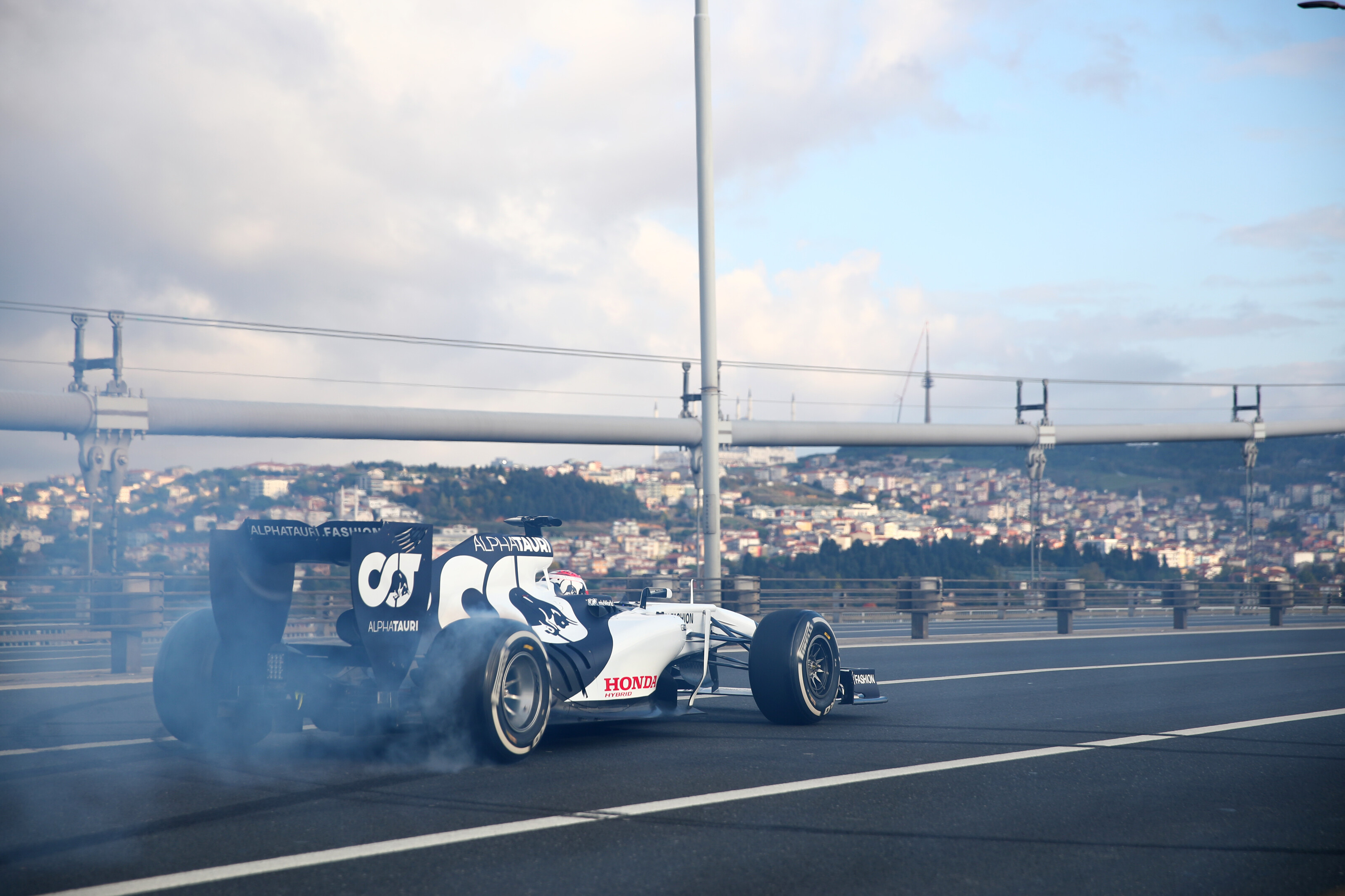 ISTANBUL, TURKEY - NOVEMBER 11: Pierre Gasly of France and Scuderia AlphaTauri performs donuts on 15 July Martyrs Bridge over the Bosphorus during the Red Bull Istanbulls show run on November 11, 2020 in Istanbul, Turkey. (Photo by Joe Portlock/Getty Images) // Getty Images / Red Bull Content Pool  // SI202011110343 // Usage for editorial use only //