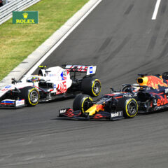 HUNGARORING, HUNGARY - AUGUST 01: Mick Schumacher, Haas VF-21, battles with Max Verstappen, Red Bull Racing RB16B during the Hungarian GP at Hungaroring on Sunday August 01, 2021 in Budapest, Hungary. (Photo by Mark Sutton / LAT Images)