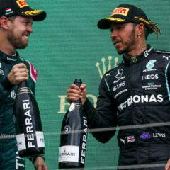 Sebastian Vettel, Aston Martin, 2nd position, and Sir Lewis Hamilton, Mercedes, 3rd position, congratulate each other on the podium